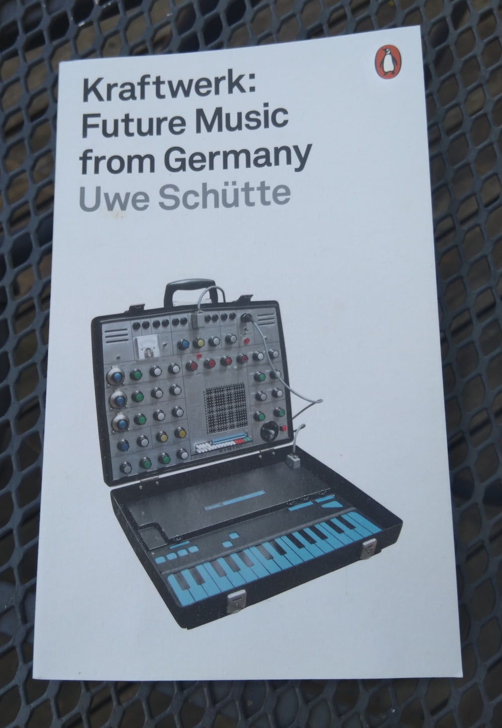Paperback edition of Kraftwerk: Future Music From Germany. It has a picture of a synthesiser in a suitcase.
